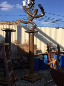 """Rolled 10"""" sch 40 pipe placed on top of a Doric style pillar with rolled half round 2"""" sch 40 pipe"""